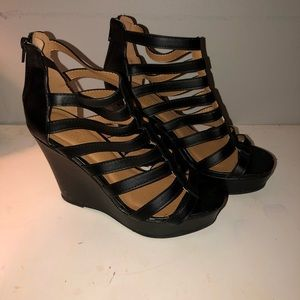 Gently used black wedge heels!